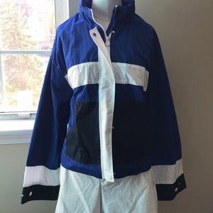 Jacket with storable hood